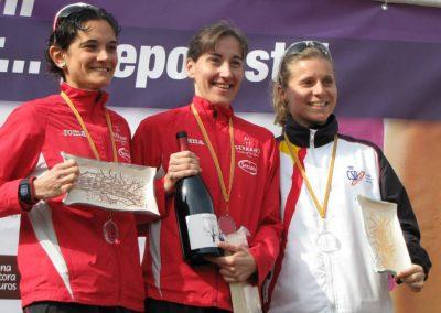 Podiums carrera día de la mujer deportista